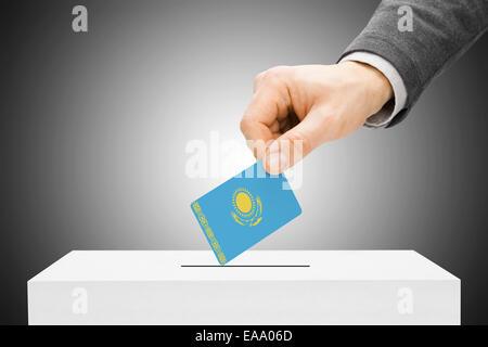 Voting concept - Male inserting flag into ballot box - Kazakhstan - Stock Photo