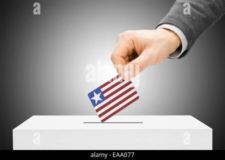 Voting concept - Male inserting flag into ballot box - Liberia - Stock Photo