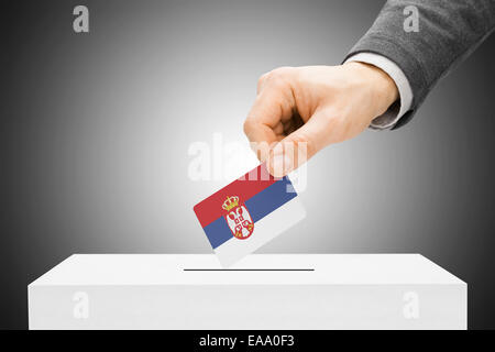 Voting concept - Male inserting flag into ballot box - Serbia - Stock Photo