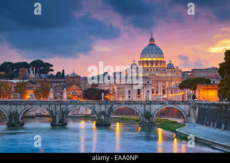 View of St. Peter's cathedral in Rome, Italy during beautiful sunset. - Stock Photo