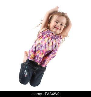 Beautiful Little Girl Jumping for Camera in Studio - Stock Photo