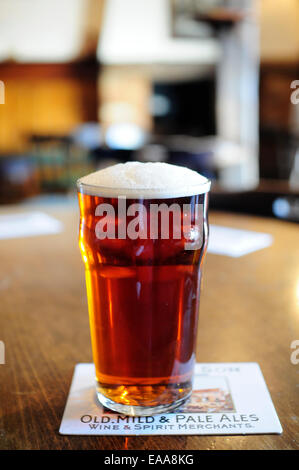 Pint of Harveys Best Bitter beer on a pub table - Stock Photo