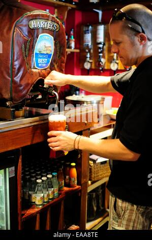 Barman pouring a pint of Harveys Best Bitter at a pub in Lewes, Sussex - Stock Photo