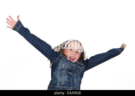 Beautiful young girl jumping in air on white background - Stock Photo