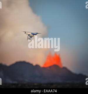 DJI Phantom 2 flying by the Holuhraun Fissure Eruption. Aerial view of lava and plumes. - Stock Photo