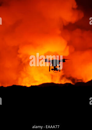 DJI Phantom 2 with GoPro, flying by the Holuhraun Fissure Eruption. - Stock Photo
