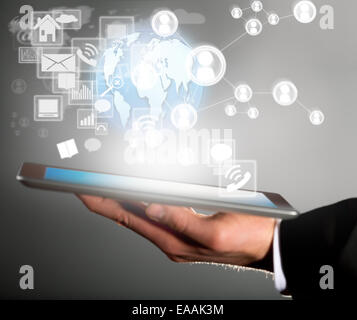 Business concept with manager holding tablet. Virtual icons around - Stock Photo