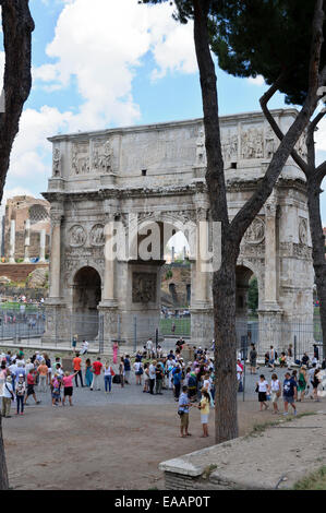 Tourists gathered near the Arch of Constantine near the Colosseum in the City of Rome, Italy. - Stock Photo