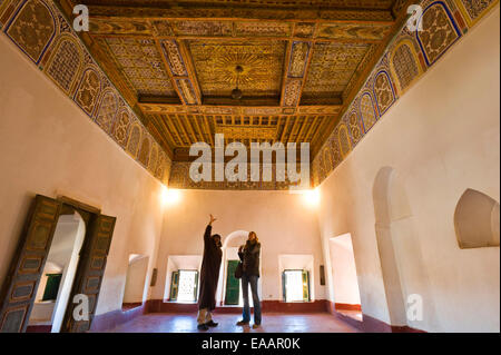 Horizontal portrait of a tour guide and tourist inside the Kasbah Taourirt in Ouarzazate. - Stock Photo