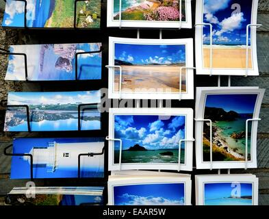 Souvenir postcards on sale outside a shop in Padstow Cornwall England uk - Stock Photo