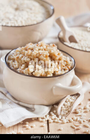 Ptititm or israeli couscous - kind of small pasta, traditional for israelian cuisine. - Stock Photo