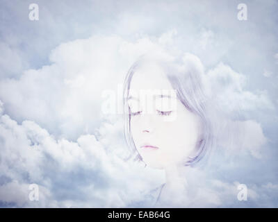 Face in clouds. Digital composite. - Stock Photo