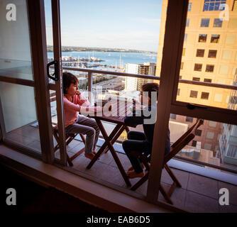 Breakfast on tiny balcony, Auckland - Stock Photo