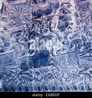 Cambodia, Angkor Wat.  Detail of Bas-relief Showing the Kaurava Army Advancing into the Battle of Kurukshetra. - Stock Photo