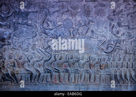 Cambodia, Angkor Wat.  Bas-relief Showing Pandava Warriors Advancing into the Battle of Kurukshetra. - Stock Photo