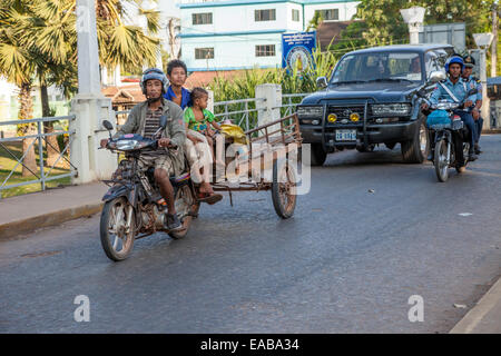 Cambodia, Siem Reap.  Street Traffic. - Stock Photo