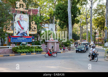 Cambodia, Siem Reap.  Street Traffic, with Poster in Honor of Former King Norodom Sihanouk. - Stock Photo