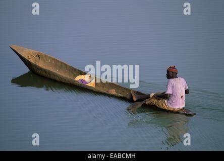 Traditional canoe on Gambia river, Niokolo Koba national park, Senegal, West Africa - Stock Photo