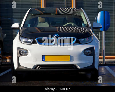 BMW i3 electric car parked at charging station in Breda, the Netherlands - Stock Photo