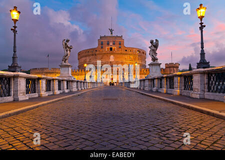 Image of the Castle of Holy Angel and Holy Angel Bridge over the Tiber River in Rome at sunrise. - Stock Photo