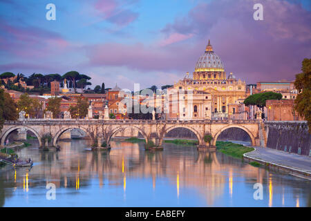 Rome. View of Vittorio Emanuele Bridge and the St. Peter's cathedral in Rome, Italy during beautiful sunrise. - Stock Photo