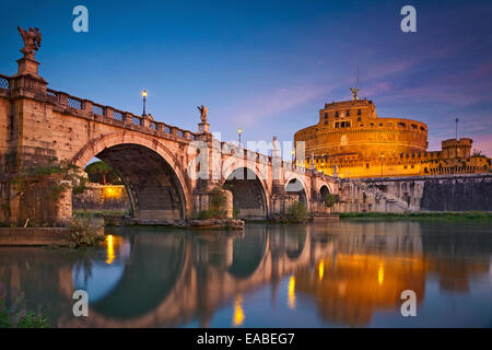 Rome.  Image of the Castle of Holy Angel and Holy Angel Bridge over the Tiber River in Rome at sunrise. - Stock Photo