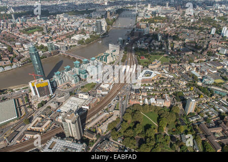 An aerial view from Nine Elms in London looking over Vauxhall Bridge towards the Houses of Parliament - Stock Photo