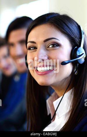 Happy young businesspeople and colleagues in a call center office - Stock Photo