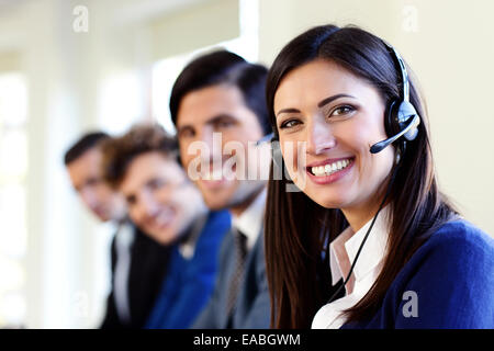 Cheerful young businesspeople and colleagues in a call center office - Stock Photo