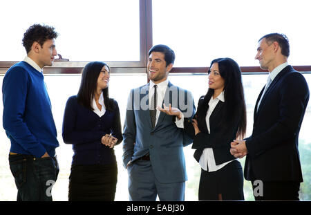 Group of business people talking in the office - Stock Photo