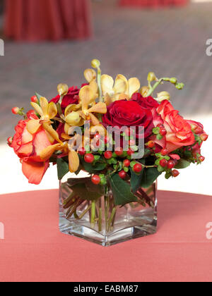 Vase of flowers on table at reception - Stock Photo