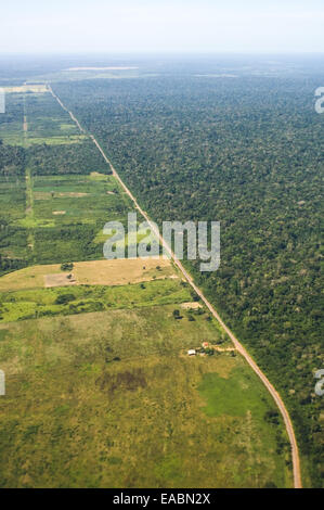 Near Sao Benedito, Para State, Brazil. Aerial view of a road which borders the forest with deforested land on the - Stock Photo