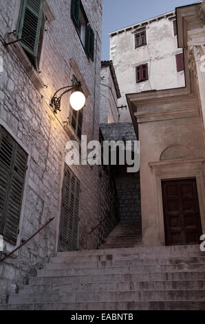 Desaturated picture of medieval street in the old town of Sibenik, Croatia - Stock Photo