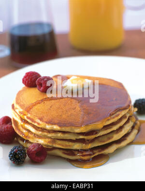 breakfast of pancakes with maple syrup and fruit - Stock Photo