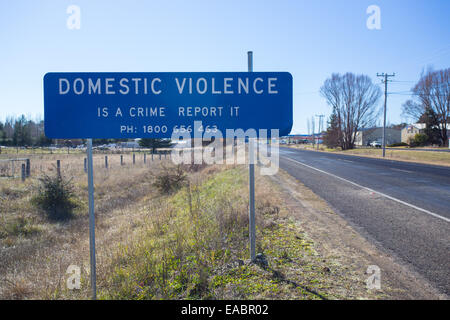 Road sign to report domestic violence, Australia - Stock Photo