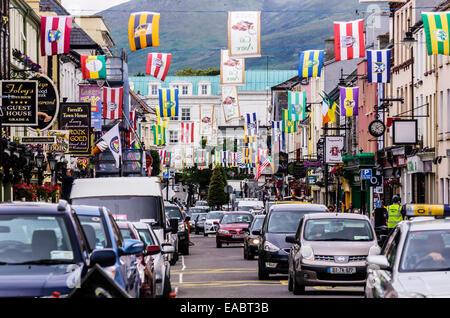 Ireland Province Munster County Kerry Killarney Shopping street flags - Stock Photo