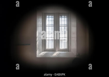 Lancaster Castle, Lancashire, UK. The 'Female Felons' Wing'. View into a prison cell through the warder's spyhole - Stock Photo