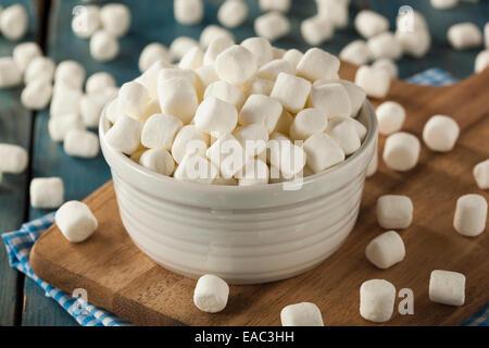 Unhealthy White Mini Marshmallows in a Bowl - Stock Photo