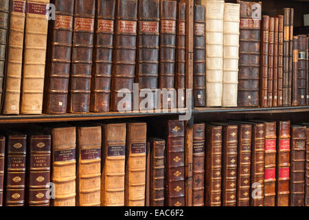 Leather bound books in the cathedral library, Wells Cathedral, Somerset - Stock Photo