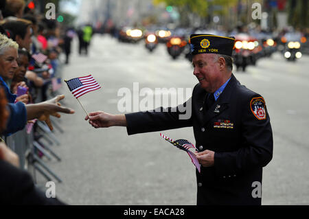 New York, USA. 11th Nov, 2014. People take part in a Veterans Day Parade in New York, the United States, on Nov. - Stock Photo