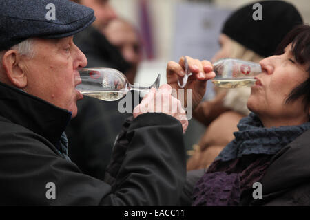 Elderly couple tastes young wine during the celebration of Saint Martin's Day in Prague, Czech Republic. Traditional - Stock Photo