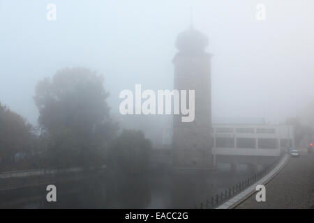 Morning fog covering the Sitkovska Water Tower and the Manes Exhibition Hall on the Vltava River in Prague, Czech - Stock Photo
