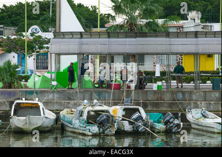 Mexican fishing boats tied up along the Campeche Melecon with fish market on sidewalk above the boats, Campeche, - Stock Photo