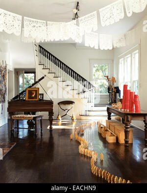 living room with formal piano and wooden figure decorations