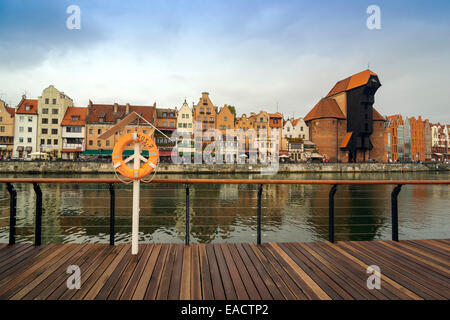 The classic view of Gdansk with the Hanseatic-style buildings reflected in the River Motlawa. - Stock Photo