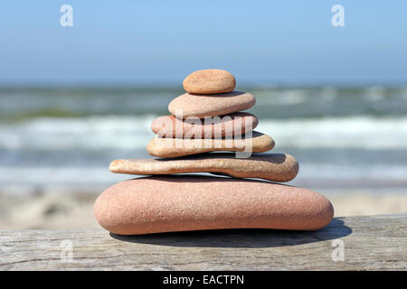 Tower made of beach pebbles, stones balancing on each other - Stock Photo