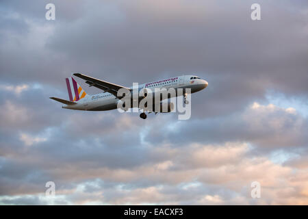 Germanwings airplane during the landing approach at Cologne-Bonn Airport at dusk, Cologne, North Rhine-Westphalia, - Stock Photo