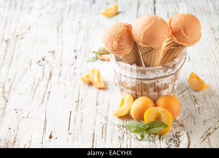Studio photo of ice cream scoops in waffle cones. Served on wooden planks - Stock Photo