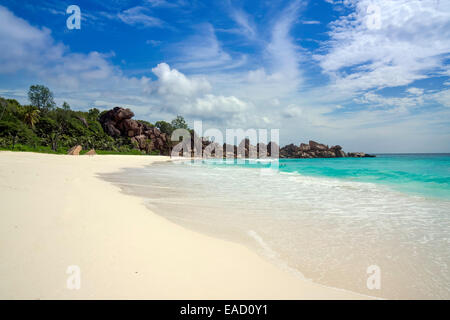 Sandy beach with the rock formations typical for the Seychelles, Grand Anse, La Digue, Seychelles - Stock Photo