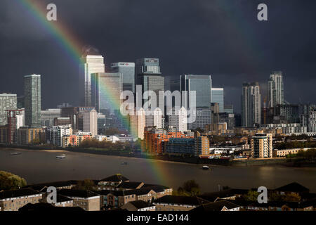 London, UK. 12th Nov, 2014.  Rainbow over Canary Wharf business buildings Credit:  Guy Corbishley/Alamy Live News - Stock Photo